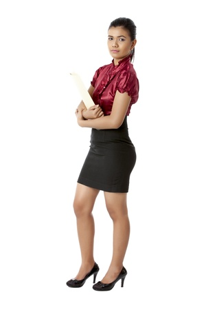 Portrait of a professional woman carrying a file folders while looking at the camera Stock Photo - 17391481