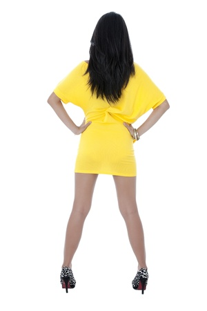 Portrait of rare view of slim lady against white background photo