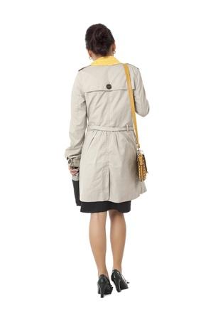 Rear view of business woman in formal wear against white background. Model: Novaliza T. Garcia photo