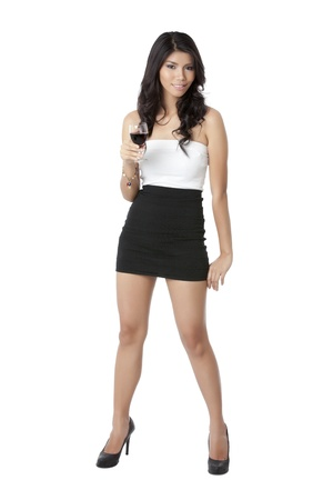 Sexy Asian model holding a glass of wine while posing for the camera