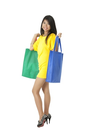 Portrait of a sexy shopper with her shopping bags isolated on photo