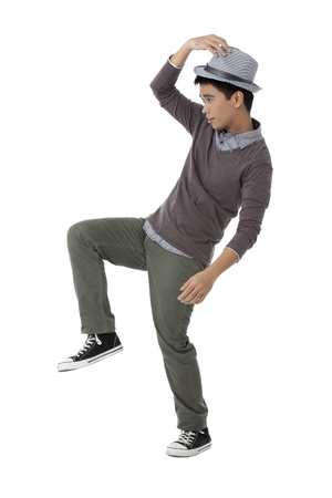 Full length portrait of teenager guy gesturing dance pose Stock Photo - 17391527