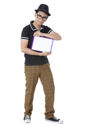 teenage guy: Portrait of teenage guy holding a white board against white background Stock Photo