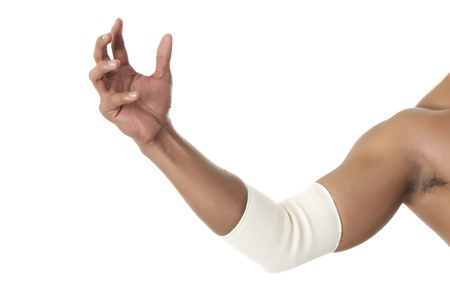 elbow sleeve: White elbow brace on a muscular arm