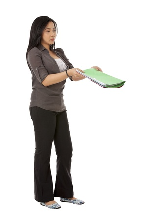 Portrait of woman giving a folder isolated on white background photo