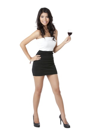 Woman with her hand on her hips and holding a wine glass on her left hand photo