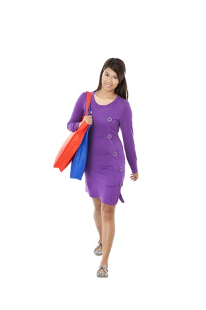 pinay: A young woman carrying a shopping bag over her shoulder Stock Photo