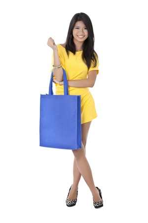 Illustration of standing beautiful woman holding a blue bag photo