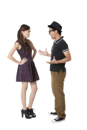 Portrait of a young Asian Model talking against white background photo