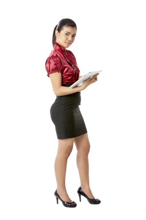 Young business woman holding a tablet over a white background
