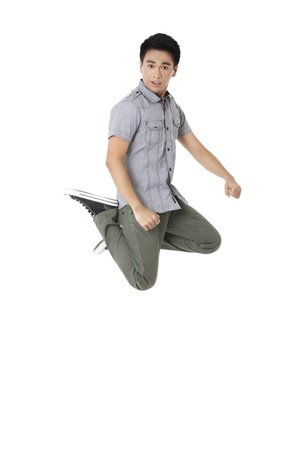 pinoy: Portrait of a young man jumping over the white background