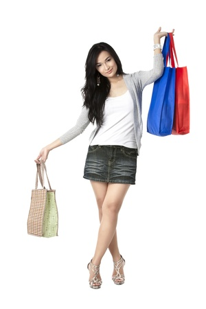 pinay: Portrait of a beautiful young woman with lots of shopping bags isolated over the white background