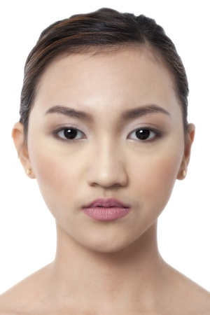 Close up image of face of an Asian model against white background Stock Photo - 17422296