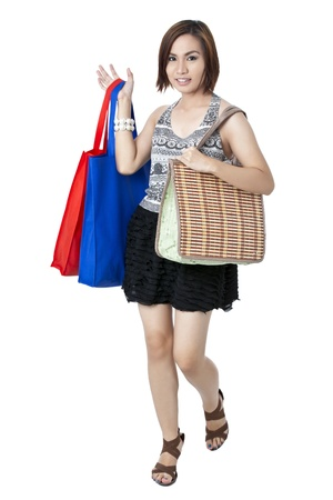mariano: Close-up portrait of a attractive female holding colorful shopping bags. Model: Jerby Mariano Stock Photo