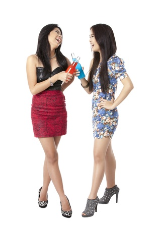 pinay: Vertical image of happy party women cheers their drinks over the white background