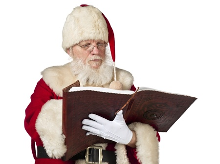 View of Father Santa Claus reading holy book. Model: Larry Lantz Stock Photo - 17390845