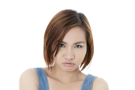 Portrait of lady on frowning face against white background Stock Photo - 17391399