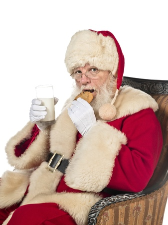 Portrait of a man in Santa Claus costume with milkshake glass and cookie. Model: Larry Lantz Stock Photo - 17390941