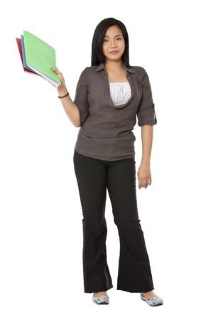 Portrait shot of a attractive young Asian woman holding colorful files against white surface. Model: Rachelle Vinluan photo