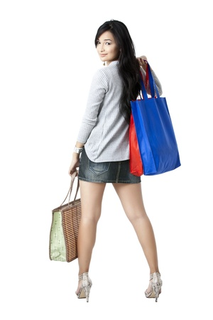 Portrait of a rear view of an Asian shopper but still looking at the camera photo
