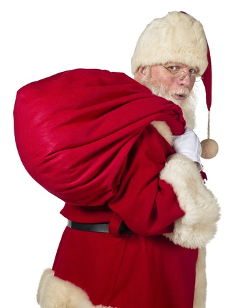 Santa Claus carrying big bag on a side view image photo