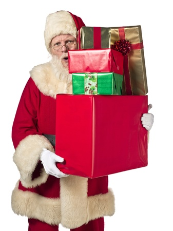 Portrait of Santa Claus holding stack of gifts on white background Stock Photo - 17390854