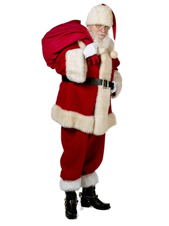 Santa Claus carrying the big sack in a full length image photo