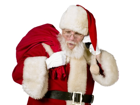 Santa Claus carrying bag of christmas gift on white background Stock Photo - 17390859