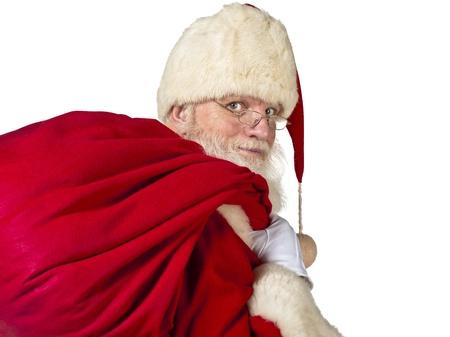 Portrait image of Santa Claus holding a gift sack against white background. Model: Larry Lantz Stock Photo - 17390850