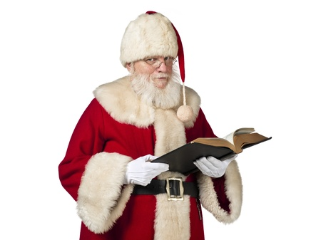 Portrait shot of Santa Claus with holy book against white background. Model: Larry Lantz Stock Photo - 17390843