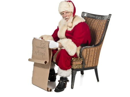 Portrait image of a man wearing Santa Claus costume and writing on scroll. Model: Larry Lantz photo