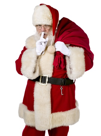 Adult Santa making a quiet gesture with a sack full of gift photo
