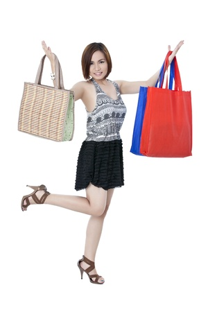 Portrait of a happy shopping lady with her shopping bags isolated on photo