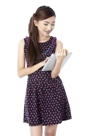 pinay: Portrait of smiling attractive lady using tablet pc against white background