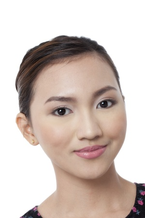 pinay: Closed up shot of a smiling womans face isolated in a white background Stock Photo