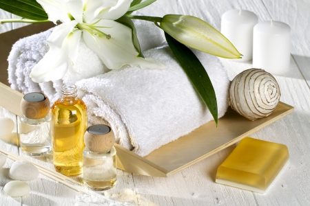 A different spa product on a white wood photo