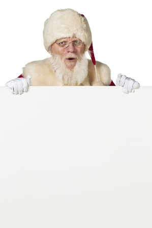 Santa clause hiding on the back of a white board photo