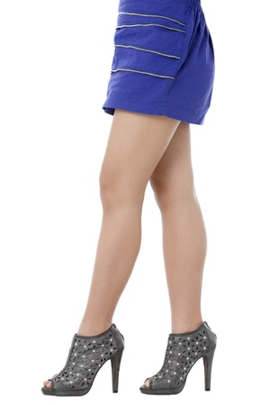 pinay: The legs of a young woman wearing a gray high heels against the white background