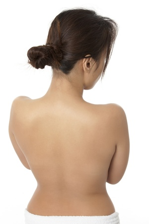 Rear view of a topless young female against white background. Model: Zhenith Dumaraos photo