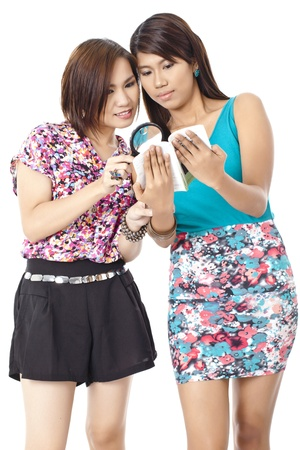pinay: Portrait of two girls investigating something against white background