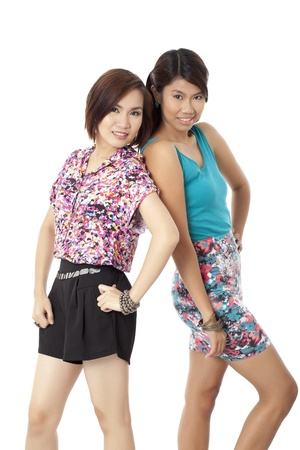 summer wear: Portrait of two lovely ladies posing with their summer wear outfit