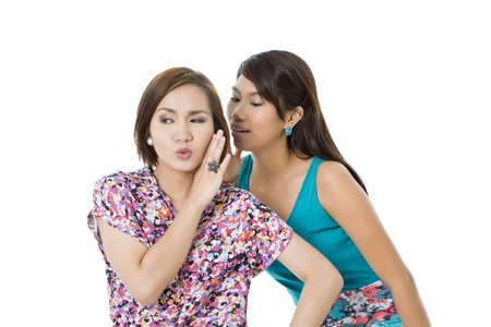 pinay: Portrait of two teenage girls talking against white background Stock Photo