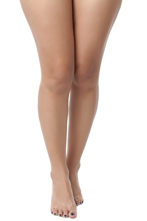 Cropped waxed legs of a young female against white background. Model: Zhenith Dumaraos Stock Photo - 17395823