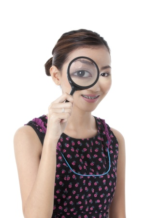 Illustration of beautiful woman looking through a magnifying glass on a white background Stock Illustration - 17422424