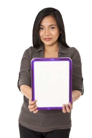 A close-up portrait of a young woman holding an empty board over the white background photo