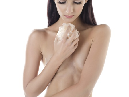 female covering her body with her arms and holding a scrubbing foam Stock Photo - 17395188