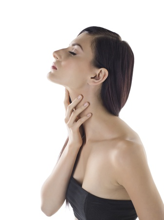 sore throat: Side view image of a sexy lady holding her throat over the white background