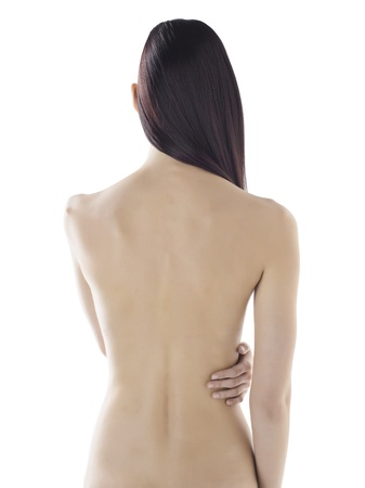 Sexy female model with long hair showing her back to the camera Stock Photo - 17395172
