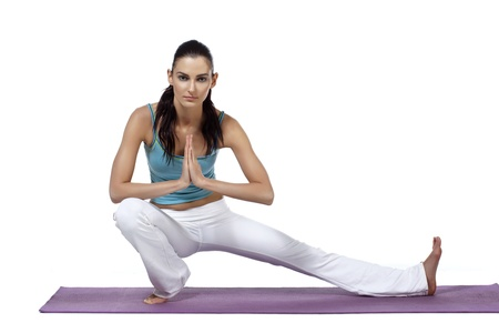 Image of  a healthy woman with her left leg stretch on the mat and facing on the camera photo