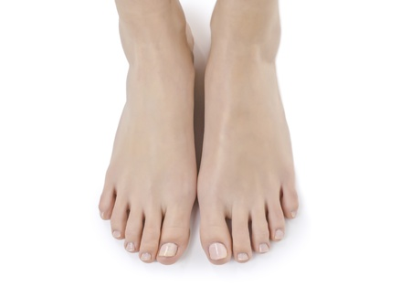 A woman's feet against white background